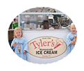 two little girls eating ice cream cones in front of Tyler's booth
