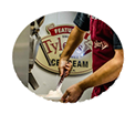 photo of man making ice cream by hand from scratch